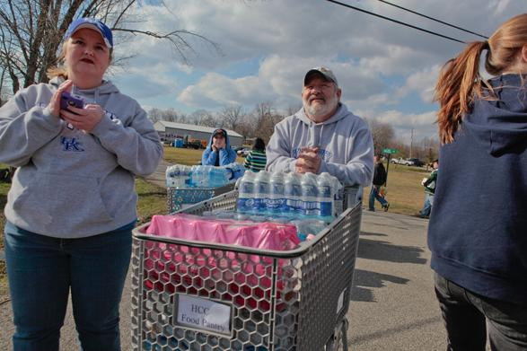 Volunteers in Henryville handed out bottled water to those working construction jobs and cleaning up debris in the heat.