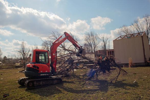 Trees from the forested areas surrounding Henryville and from the town itself were torn from the earth and had to be lifted and removed by construction workers.
