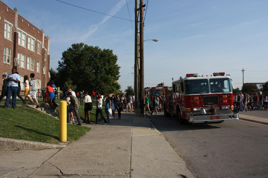 Students proceed back toward school, passing one of the two fire trucks. Photo by Molly Loehr