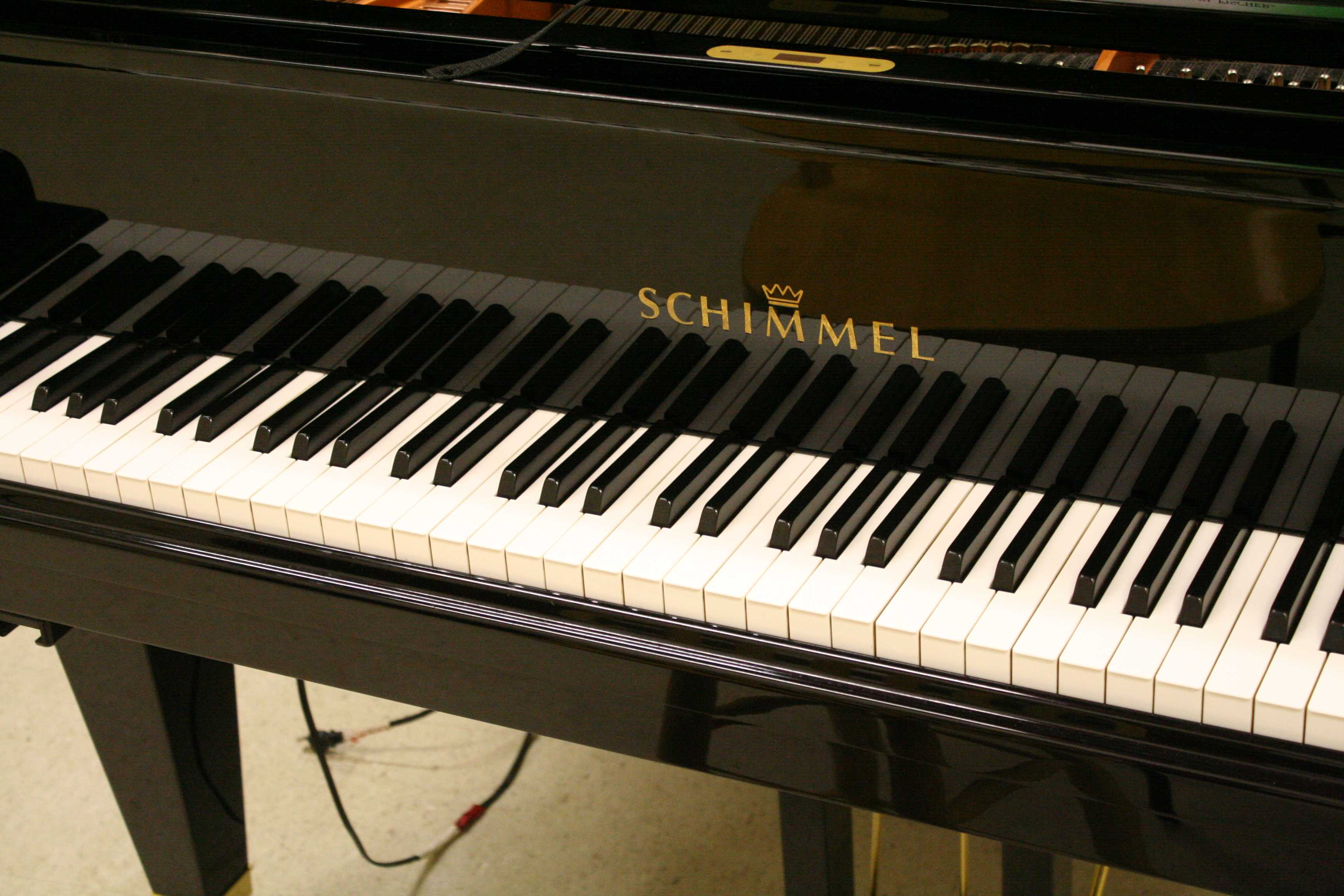 The piano Mr. Cook uses to direct the class.