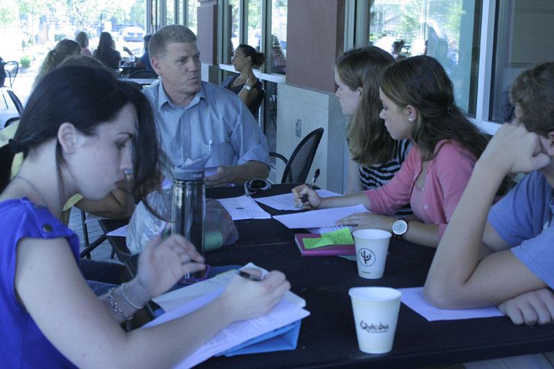 Shelby Oney (12), Mr. Jensen, Emily McConville (12), and Emily Meffert (12) discuss Idea Festival