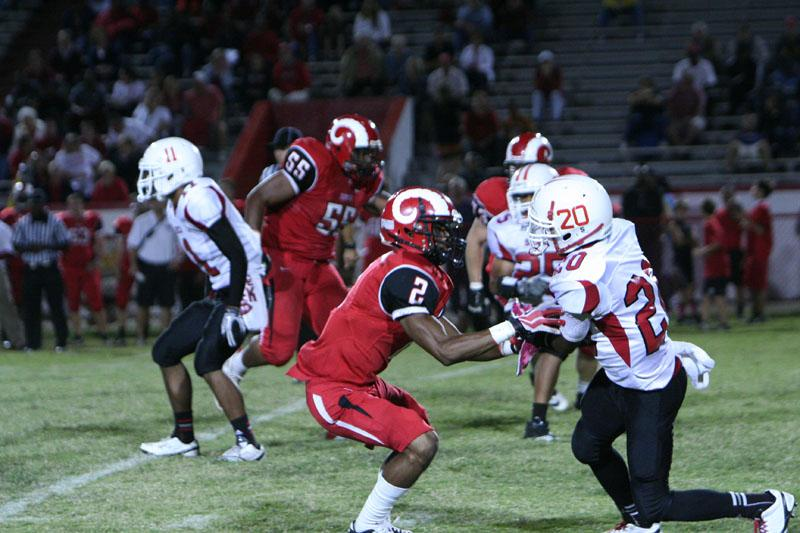 Miles Thompson (12) attempts to stop Seneca player from advancing. Photo by Jacqueline Leachman