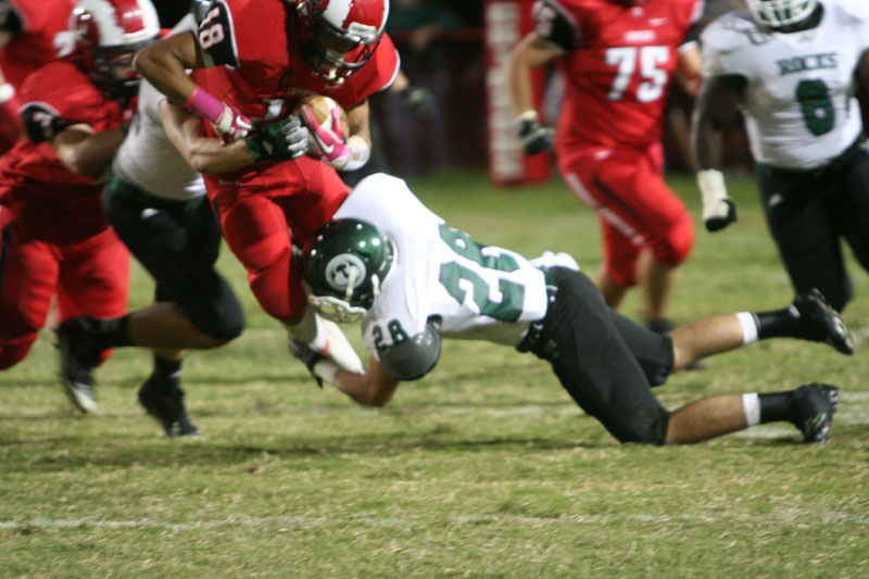 Dishan Romine (12) tackled by rock player. photo by Destony Curry