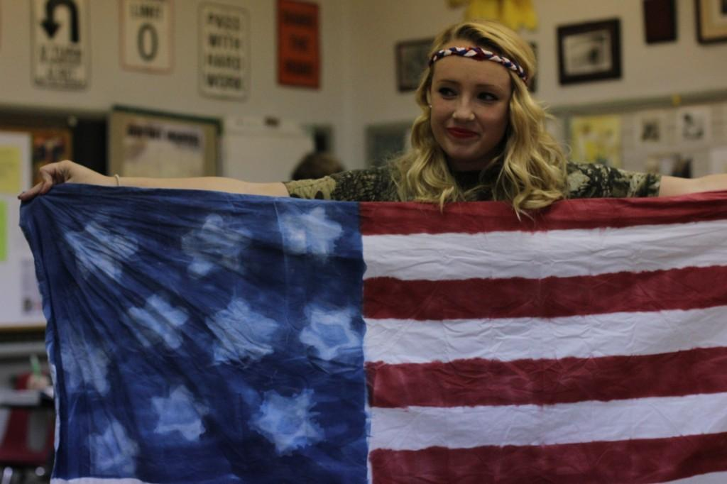 Allie Thrailkil, (11) shows her homemade American flag. Photo by Samantha Klein