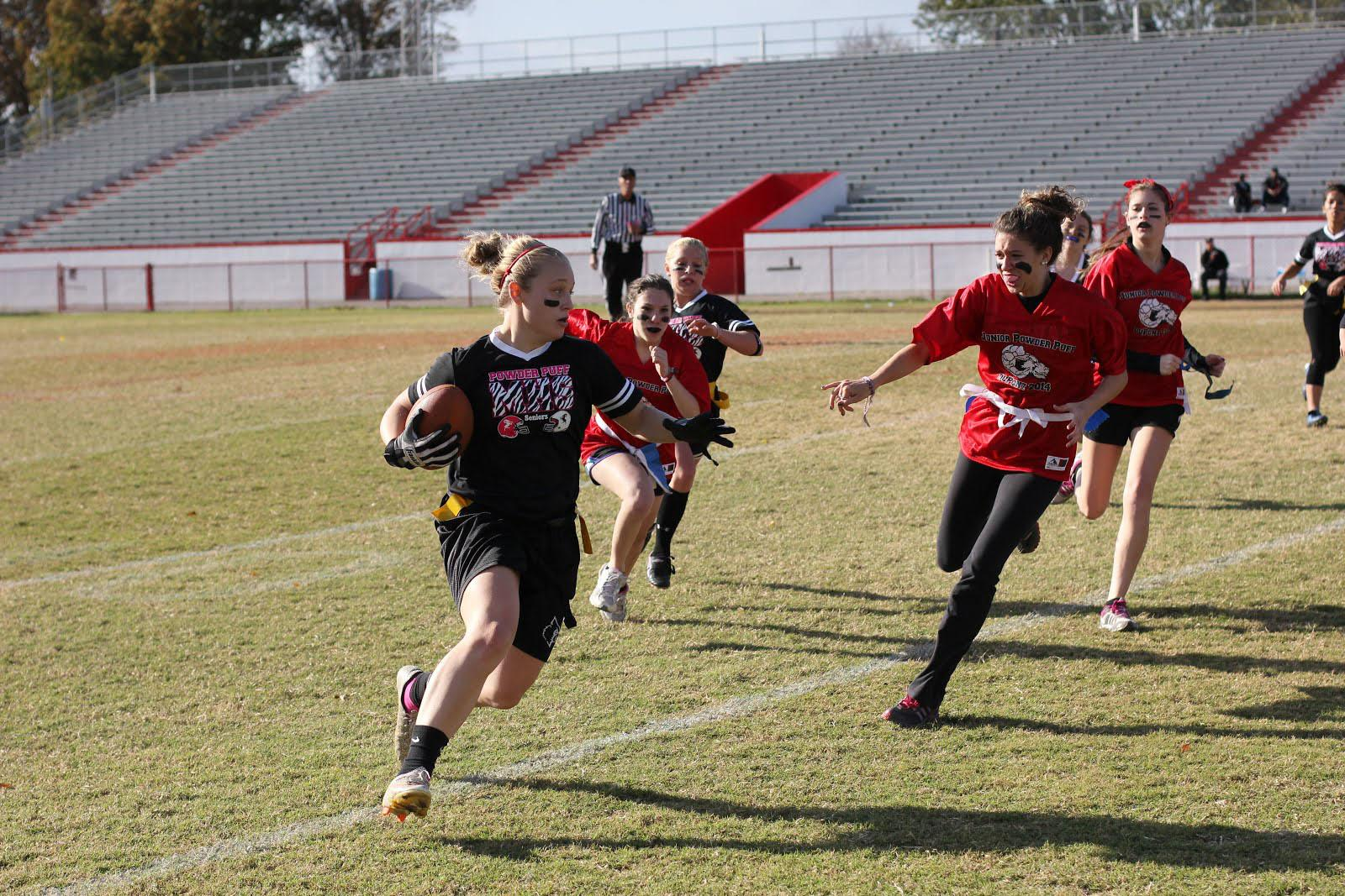 Wide receiver, katie Long (12) runs the ball down the sideline for a touchdown.