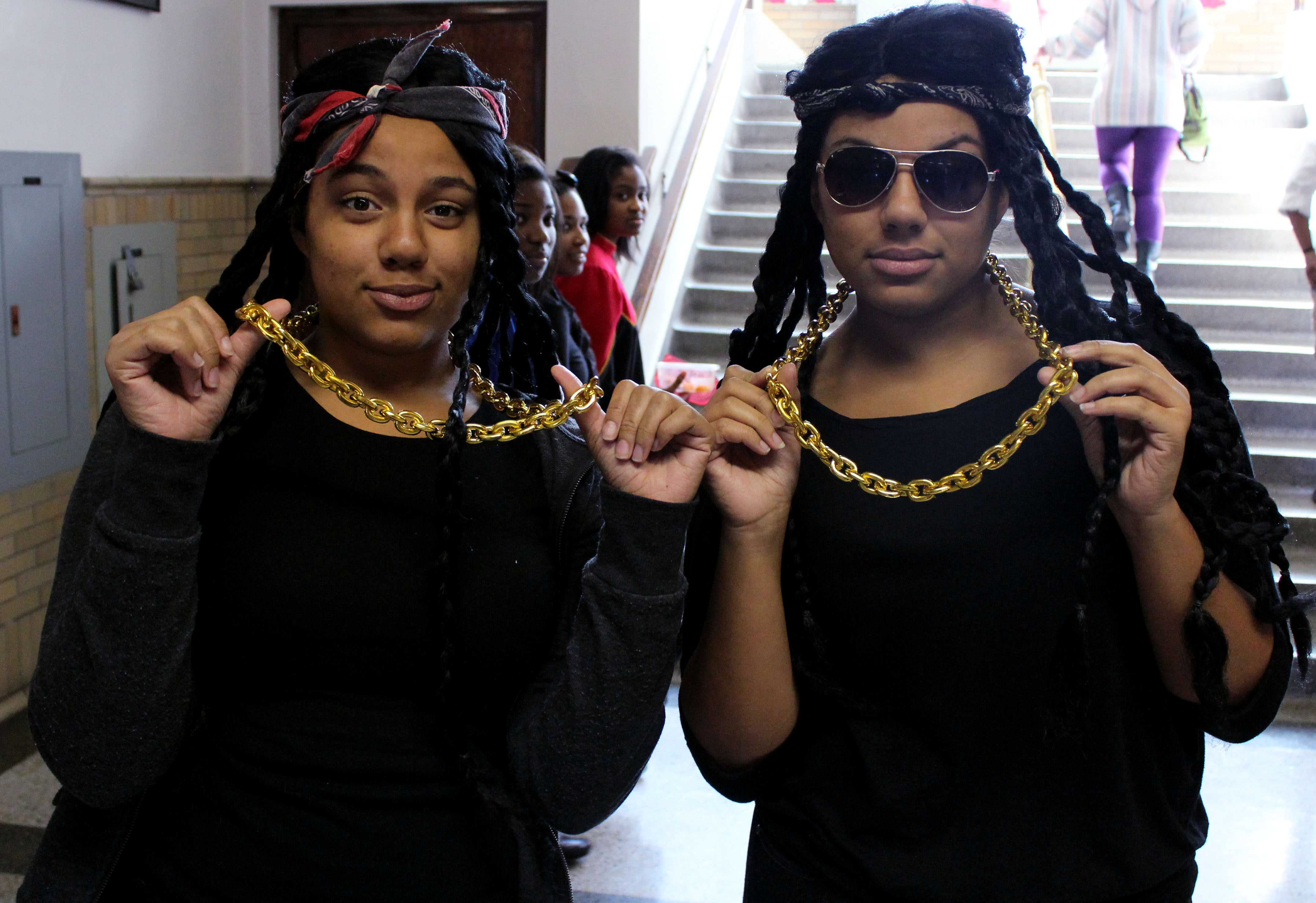 Kylie Gray (11) and Kiara Gray (11) dress as the rapper 2 Chainz and each one of his chains for Costume Day for Red/White Week. Photo by Mesa Serikali