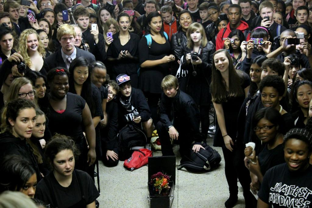 Students+gather+around+the+casket+to+listen+to+the+eulogy+given+by+Assistant+Principal+Mr.+Greg+Kuhn.+Photo+by+Mesa+Serikali