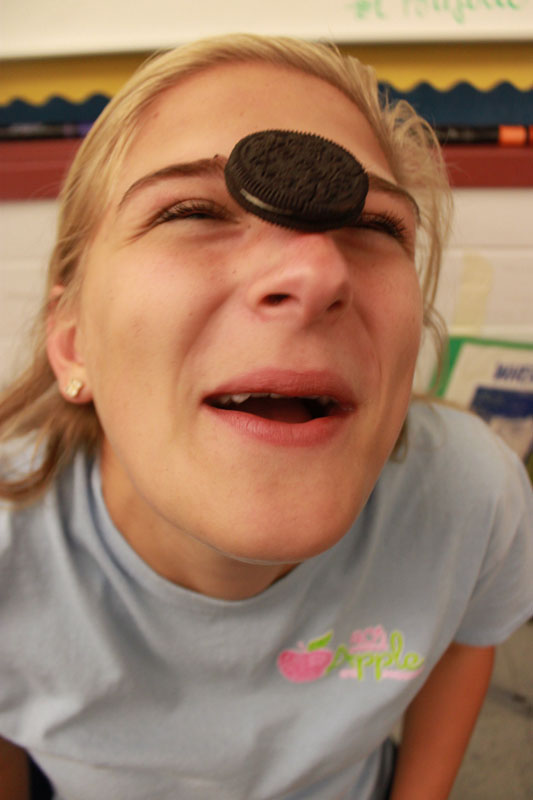Meredith Bell (12) has gotten the oreo onto her nose, but still has a ways to go before she can win the challenge. By Meg Shanks