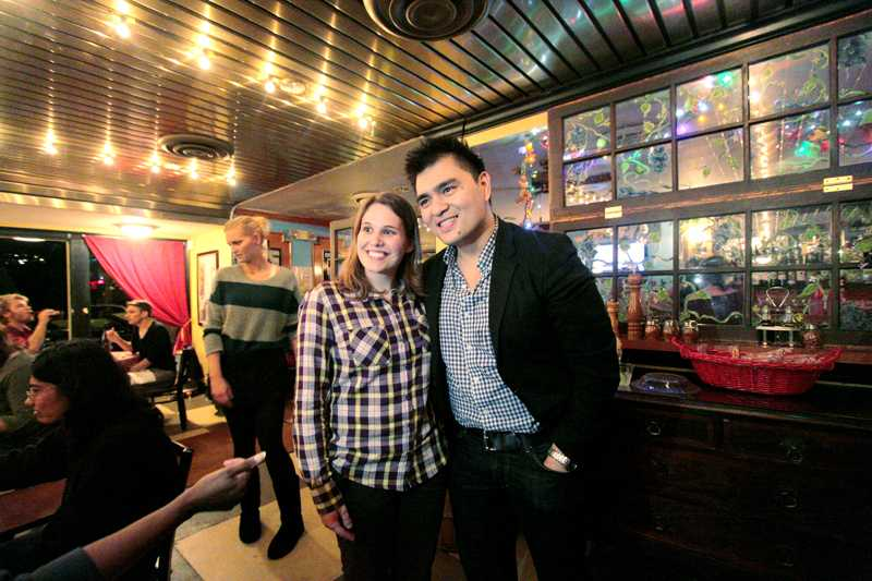 University of Louisville student poses with journalist, Jose Vargas on Wednesday, October 3, 2012 during the keynote after party at Amici's Cafe. photo by Yazmin Martinez