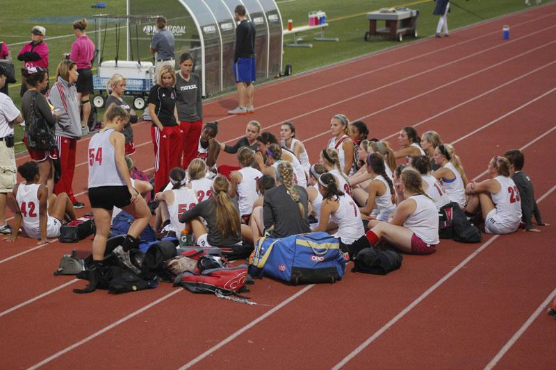 Coach Brittany Tolan talks to the team after the tough loss to Sacred Heart. Final score 6-0. Photo by Kinsey Ball
