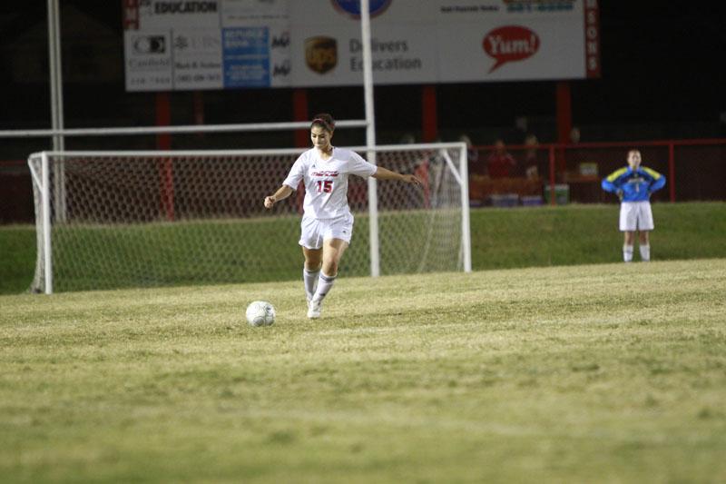 Melissa Kapsalis (11) kicks the ball down the field towards goal.