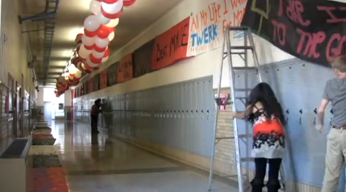 Students set-up and decorate the halls for the preparation of Red/White Week.