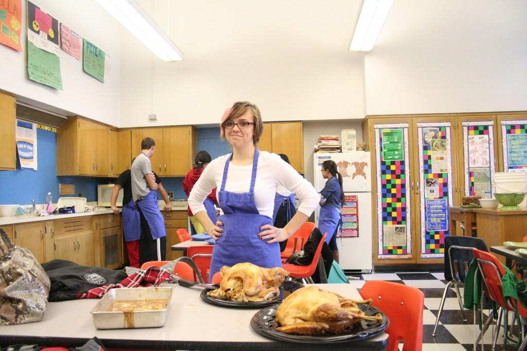 Elena Zuber (12) waits to carve the turkey in foods class 2012. Photo by Jacqueline Leachman