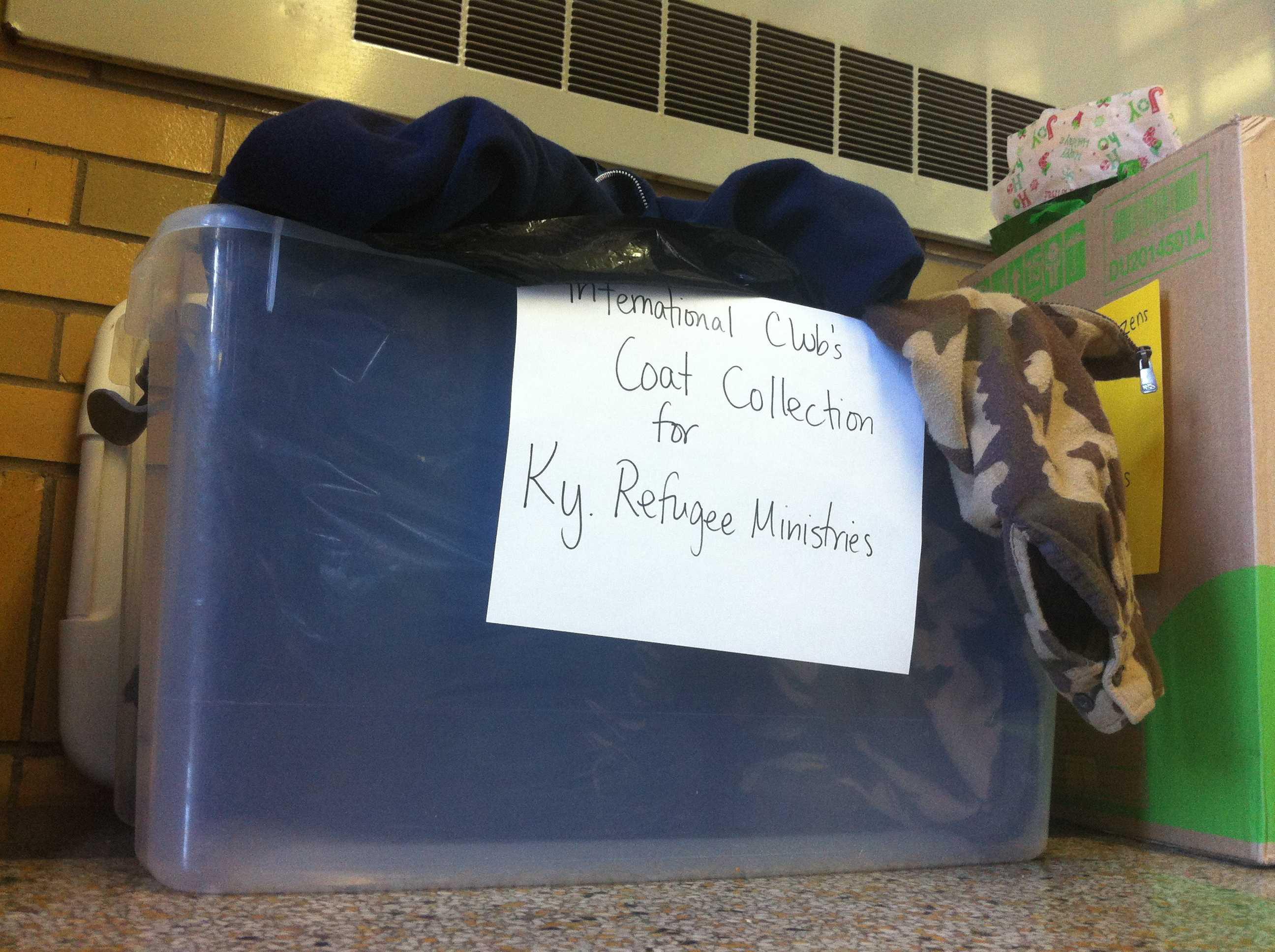 International Club holding coat drive