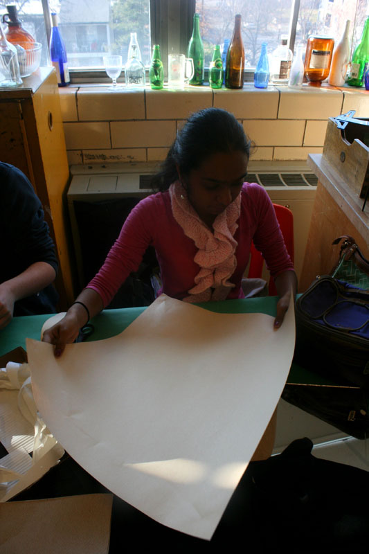 Shivani Jindal (9) surveys her piece of construction paper, thinking of ideas for her creation