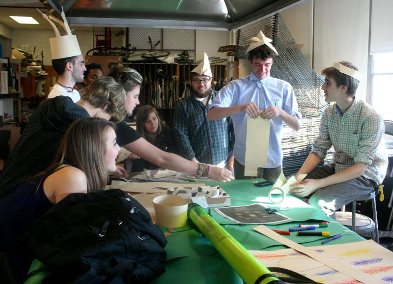 VA upperclassmen laugh as they come up with ridiculous ideas for hats.