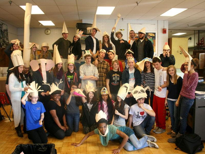 Struggling to simultaneously pose for a group photo on Mr. Deweese's behalf, Art Club members each do their own poses reflective of the hats they just made