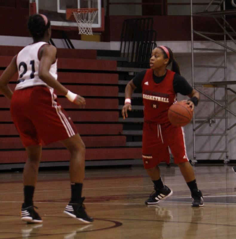 Sophomore%2C+Teanna+Curry%2C+dribbles+the+ball+while+being+guarded+by+Mackinley+Poole.