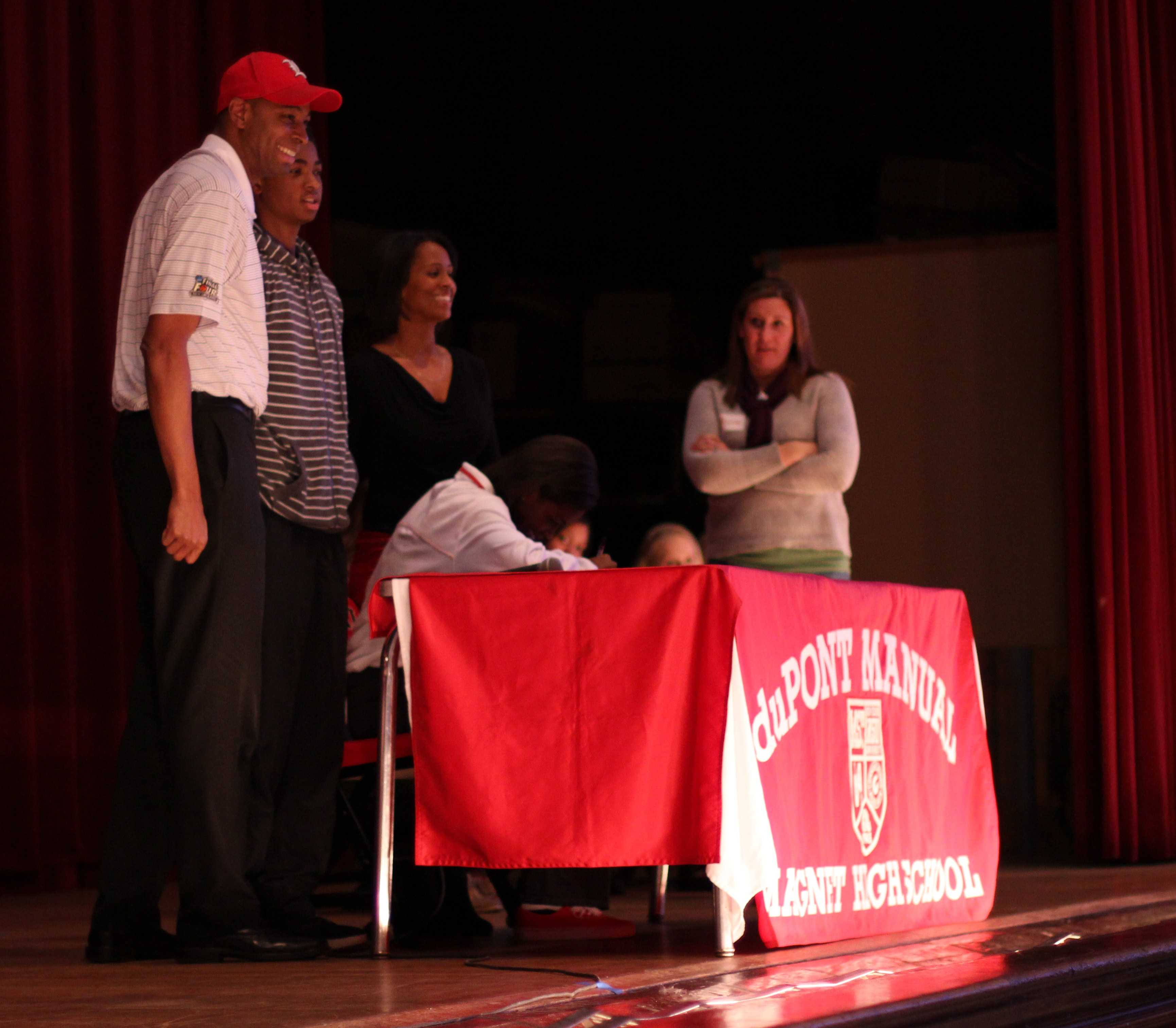 Maya McClendon, (12) signs her letter of intent to play volleyball at the University of Louisville.