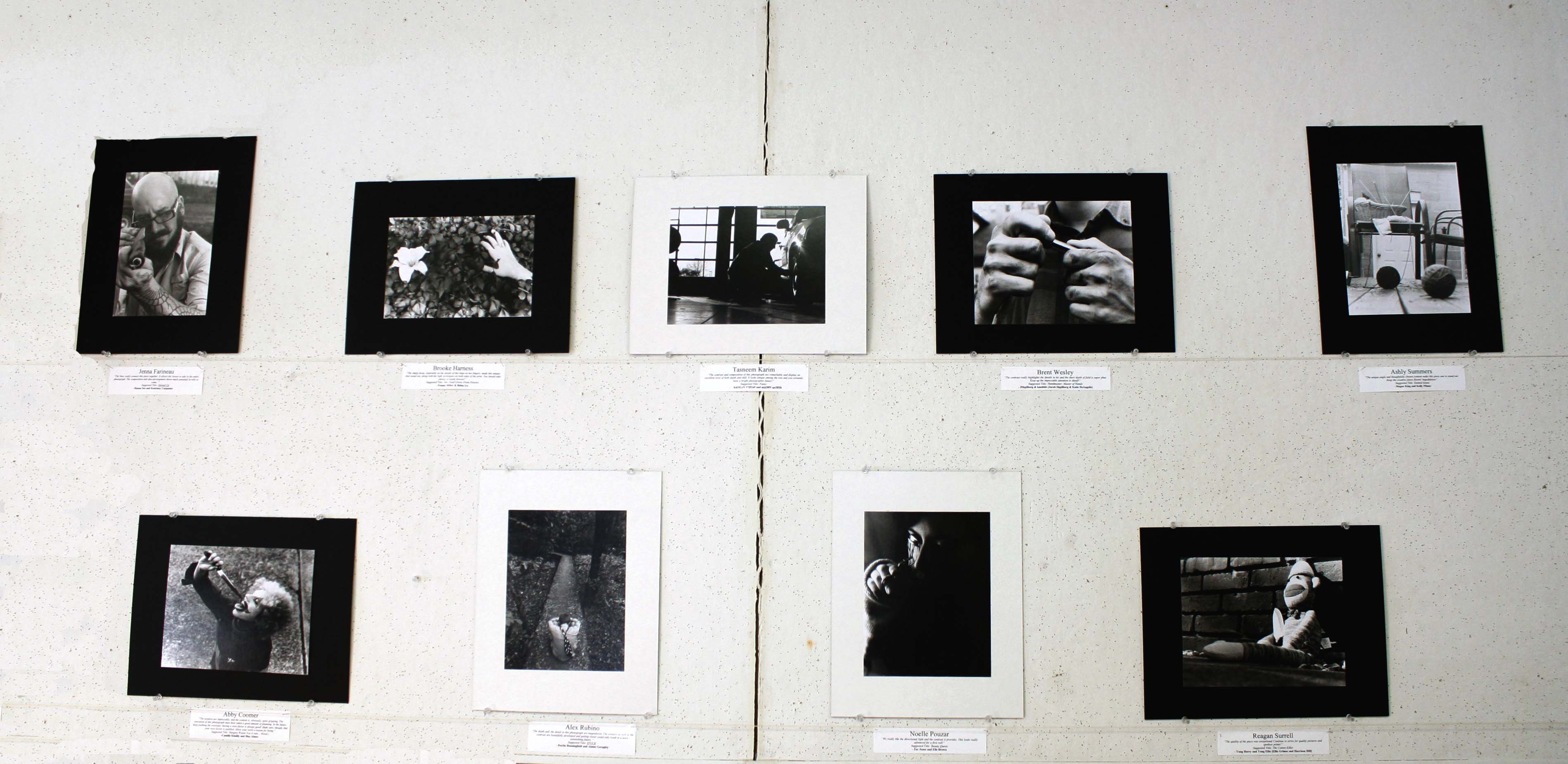 Mr.Curtis hangs some of the best photographs taken by his students on a wall in his room