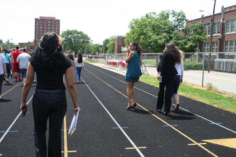 Ms. Johnson (Computer Apps Teacher) walks to her class' destination on the football practice field.  Photo By: Alexis Weaver