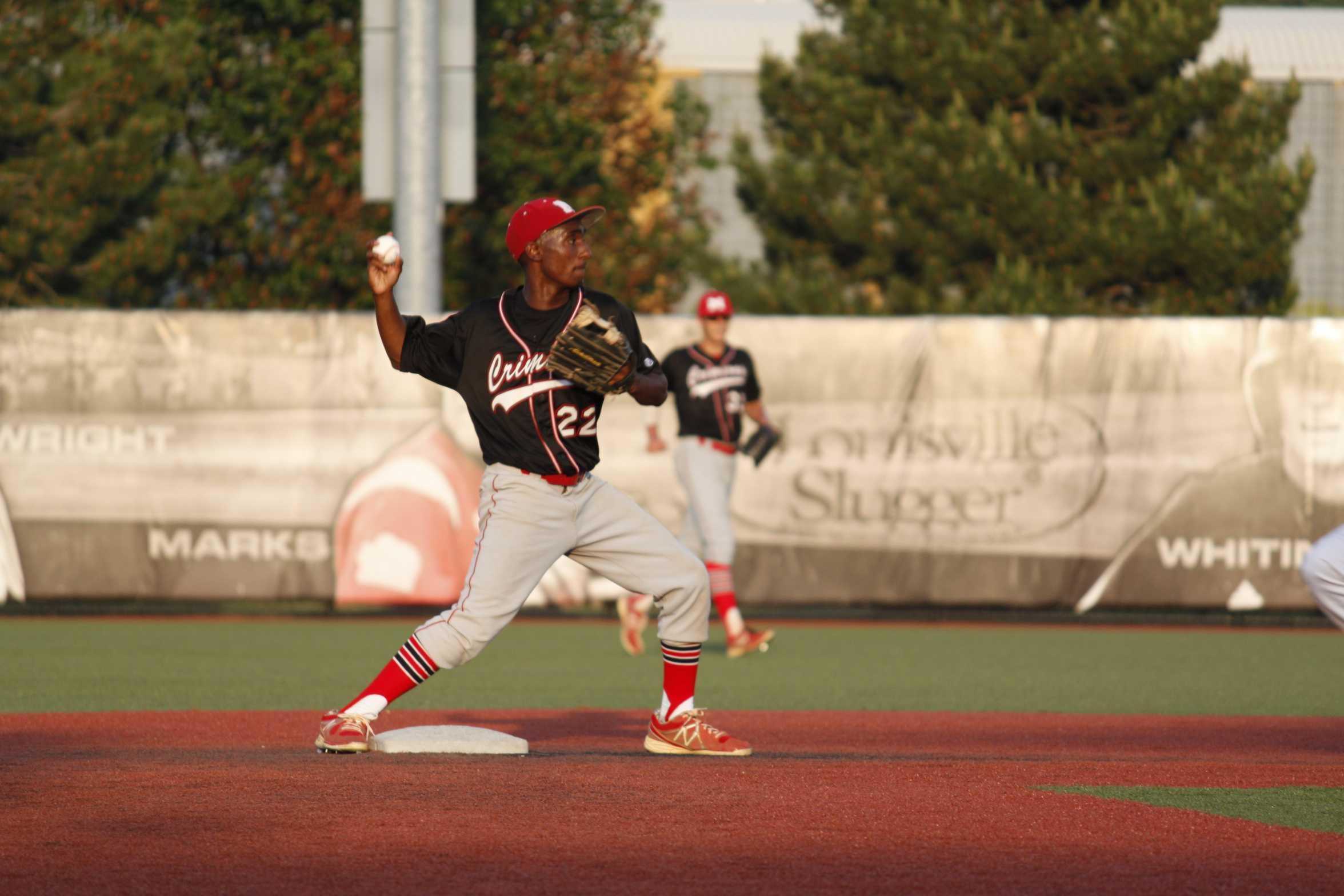 Tuarhn Gordon (11) throws the ball to first base.