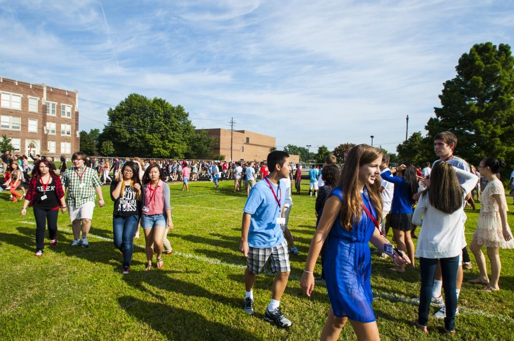 The+still+blazing%2C+Summer+heat+beats+down+on+students+as+they+stand+in+the+field.+Photo+by+Jack+Steele+Mattingly+