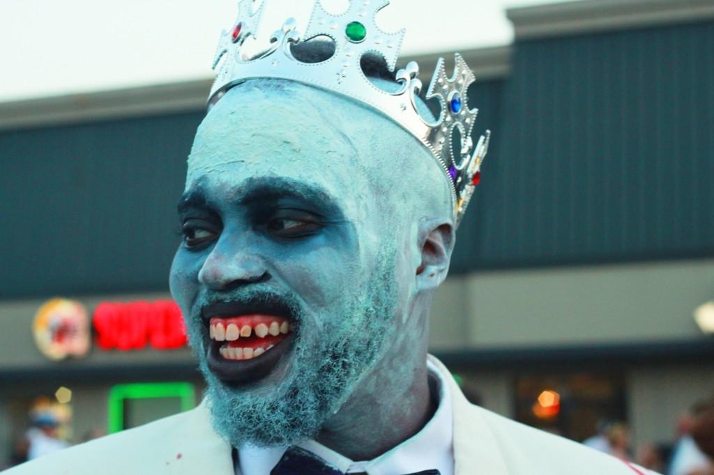 A zombie king eagerly awaits the walk.