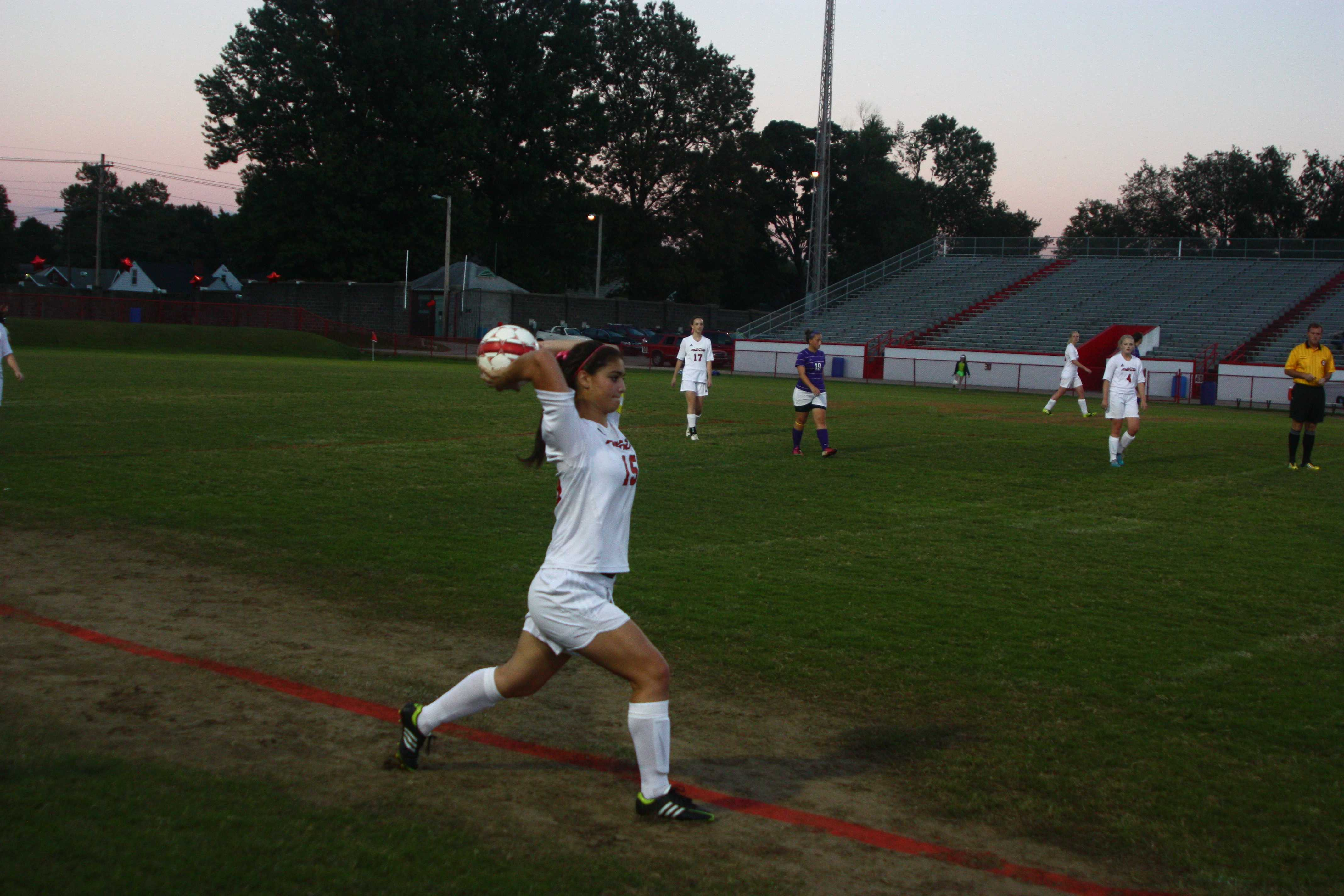 Melissa Kapsalis (12, #15) throws the ball in after an out of bounds call on Bardstown