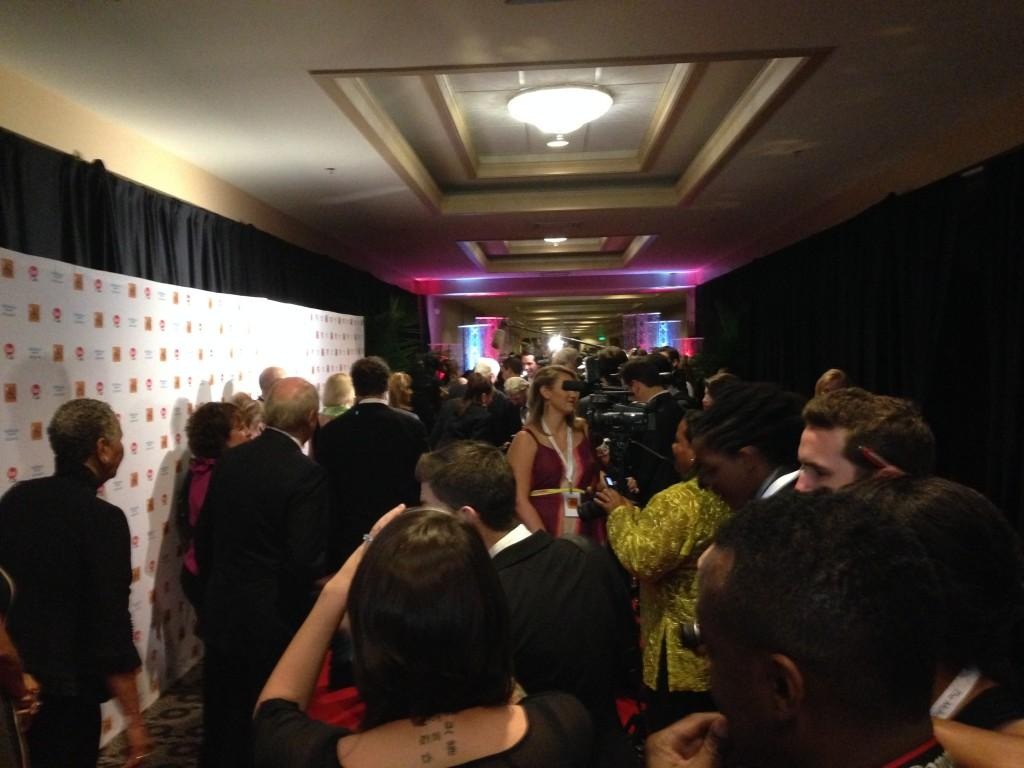 Special Guests and journalists line the red carpet at the Humanitarian Awards