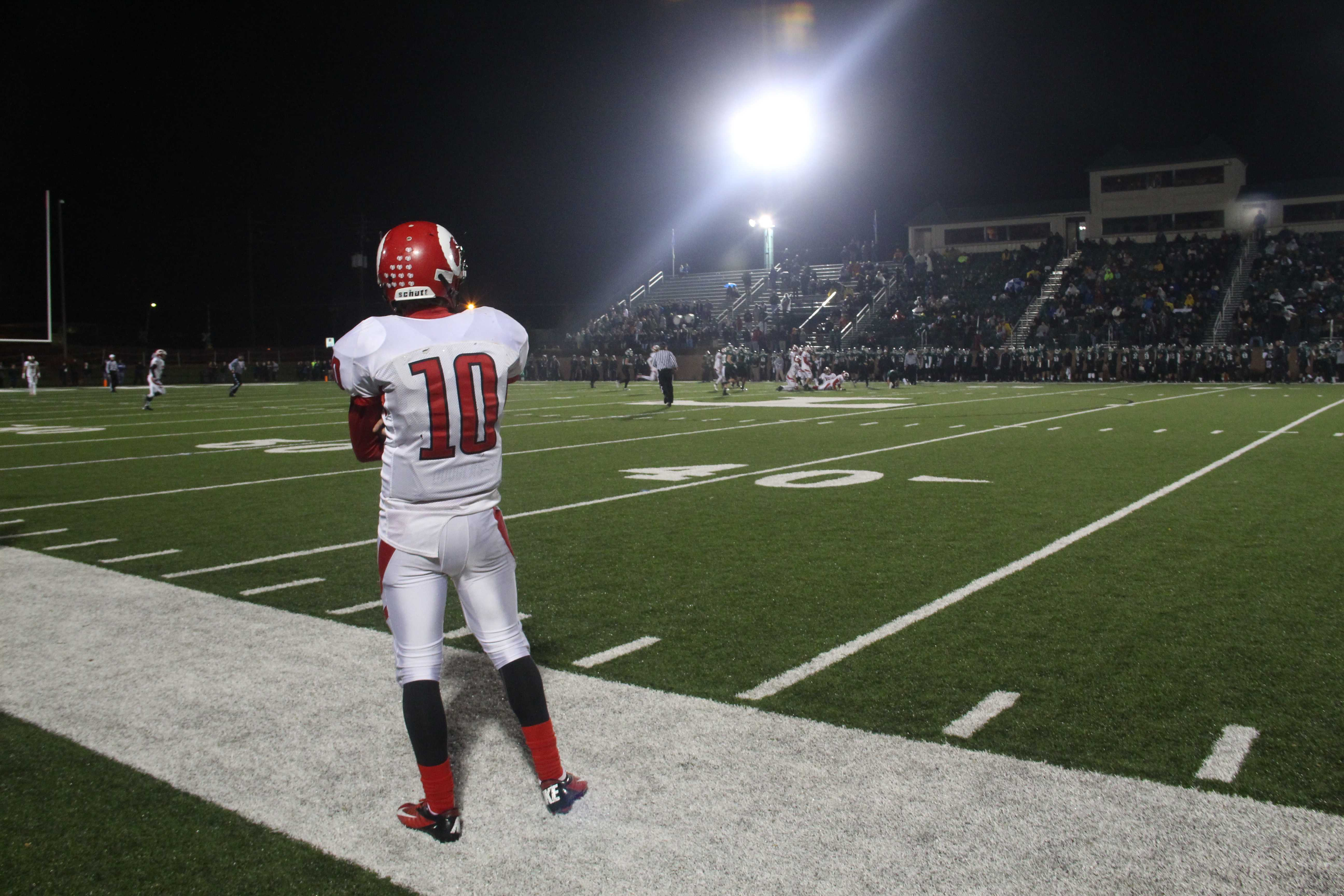 Mason Motley (#10) stands on the sidelines taking a break during the 3rd quarter.