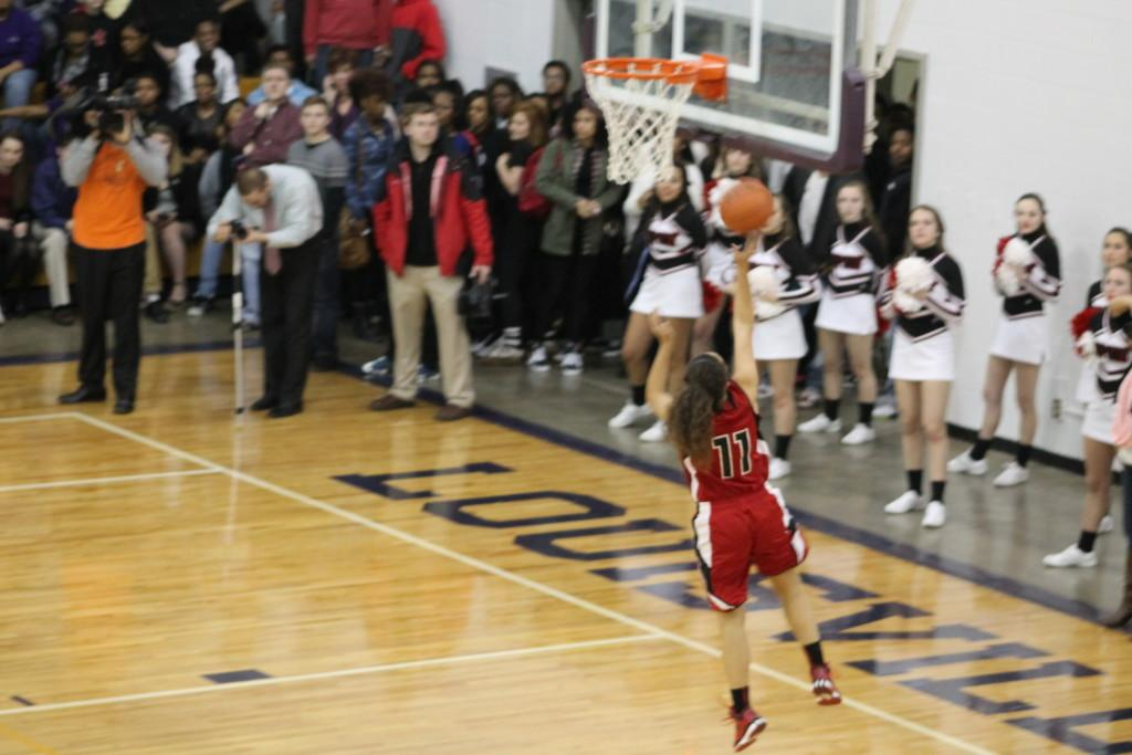 Ami Ballard hits a layup after stealing the ball and running down the floor. Although it was Ballard's only shot of the game, it came at a crucial point in the fourth quarter and shifted the momentum in Manual's favor.