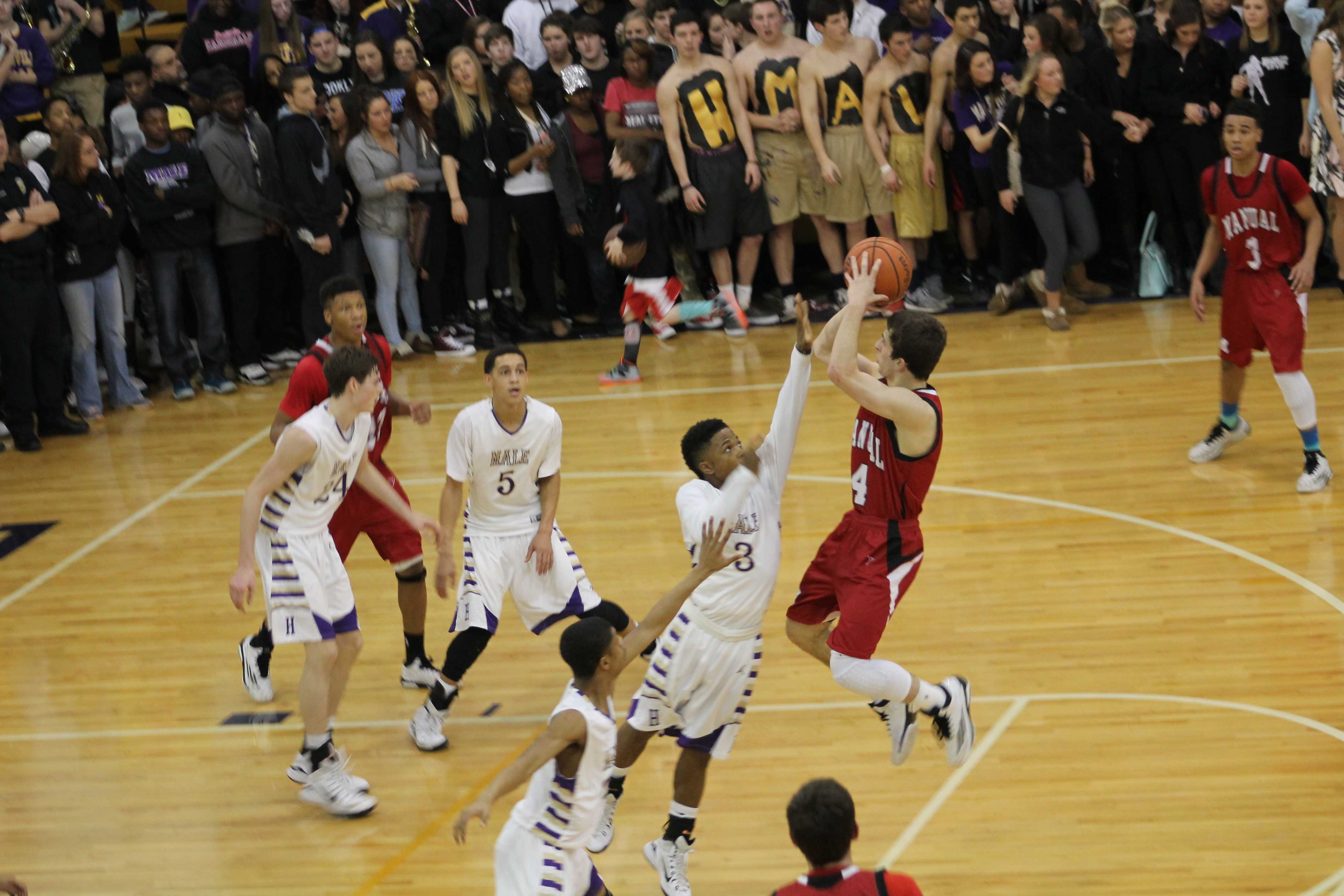 Jarrett Harness (12, #4) goes up for a shot. Harness is one of the team's leading scorers, but had a fairly quiet game.