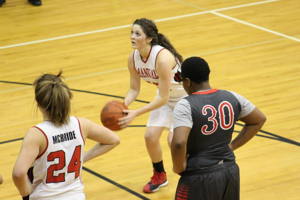 Sydney MacBlane (11, #22)  shoots a free-throw to give the Lady Crimsons a 26 point lead in the third quarter.