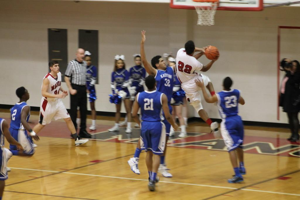 Dwayne Sutton (12, #22) goes up for a layup. Sutton is Manual's leading scorer this season.
