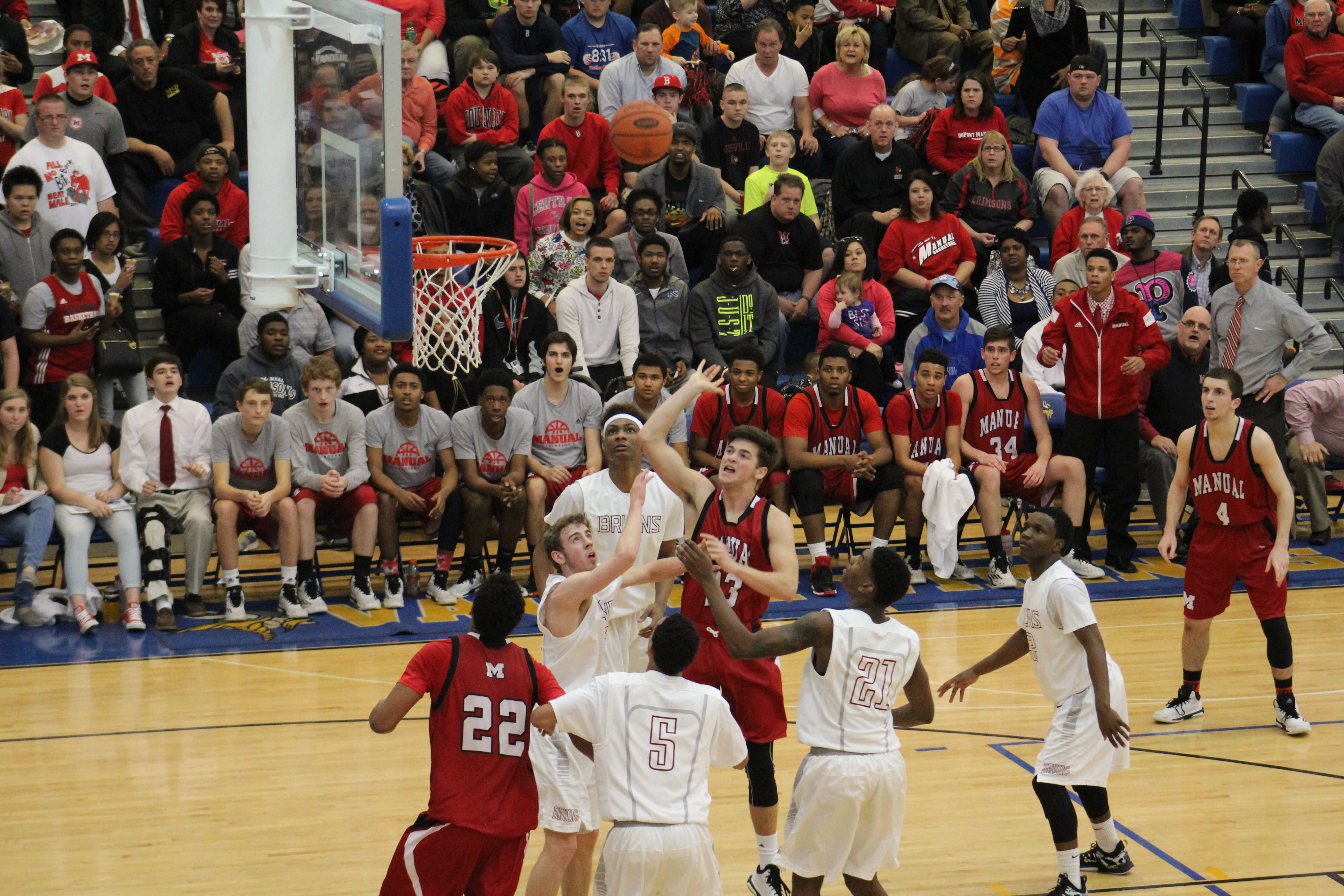 Eric Neiman (#33) jumps for a rebound during the middle of the third quarter.
