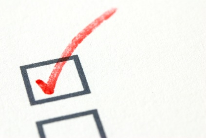 Red checkmark in a checkbox on white paper.