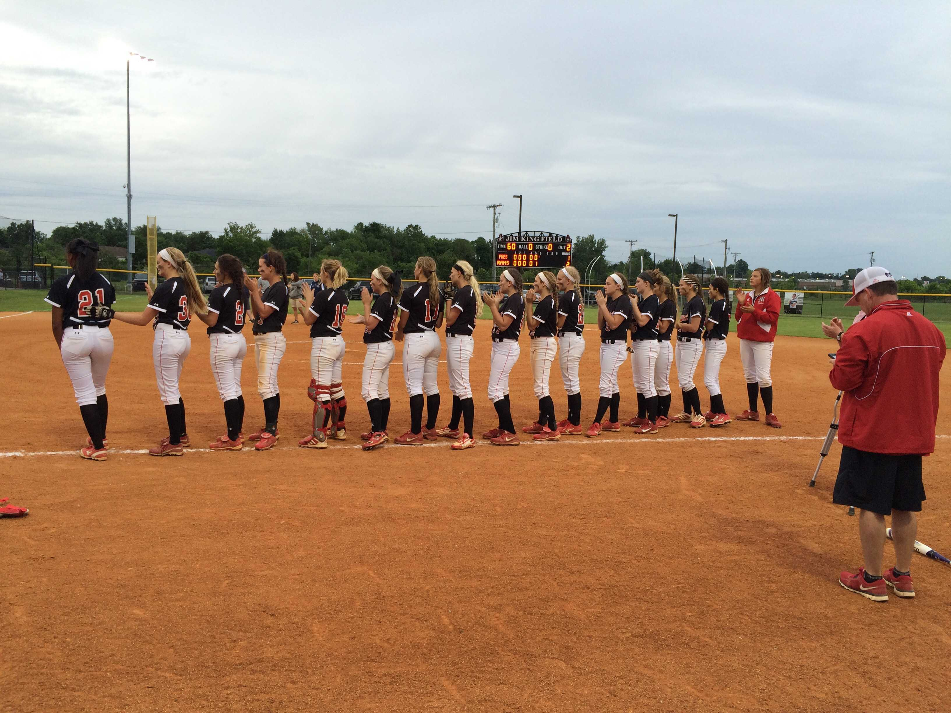 The duPont Manual softball team lines up after the game to be honored as the 25th District champions. This photo was taken pre COVID-19. Photo by RJ Radcliffe
