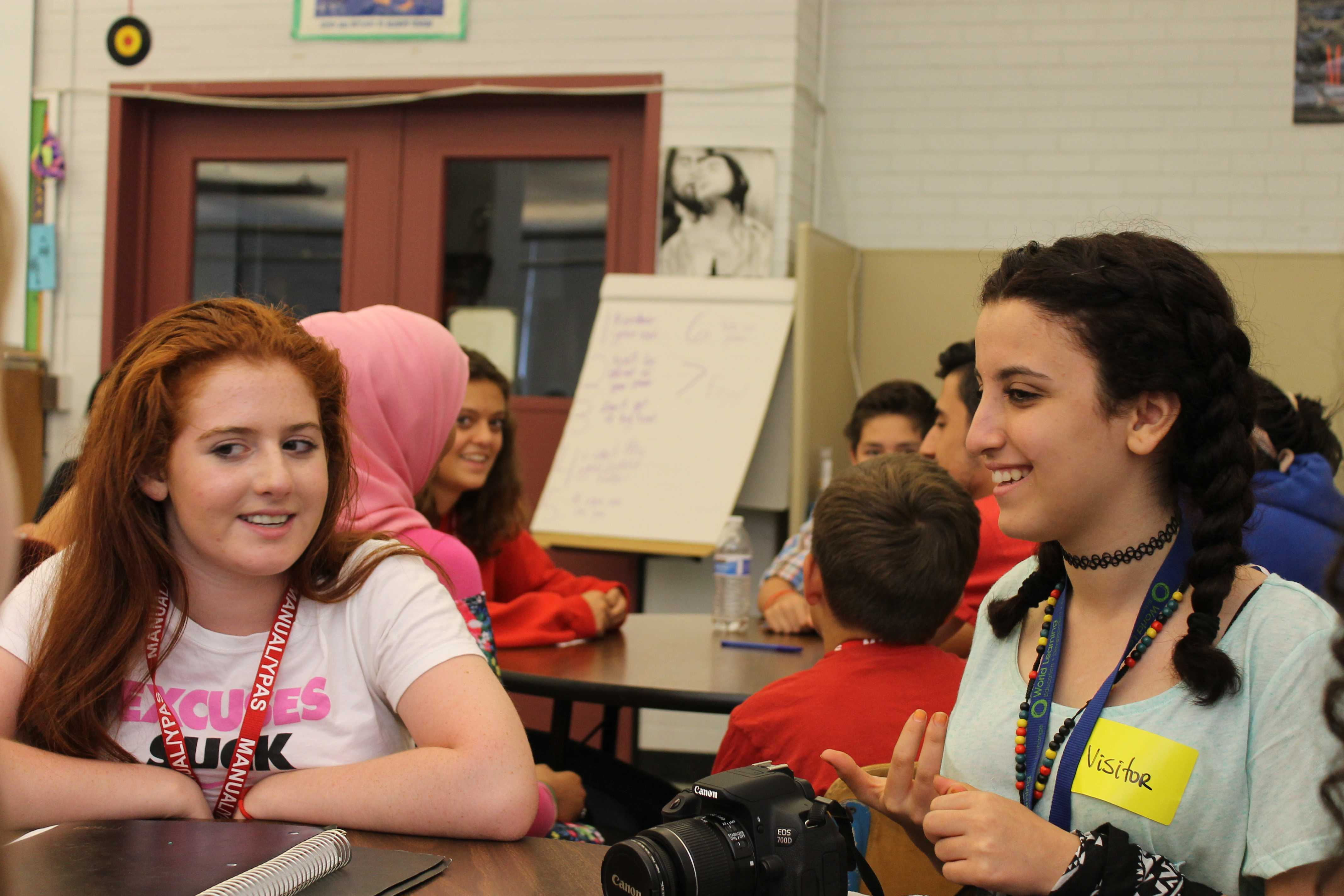 Lucy Calderon (9, J&C) and Mirna Alsi in English I (Ritchie). Photo by Haeli Spears.