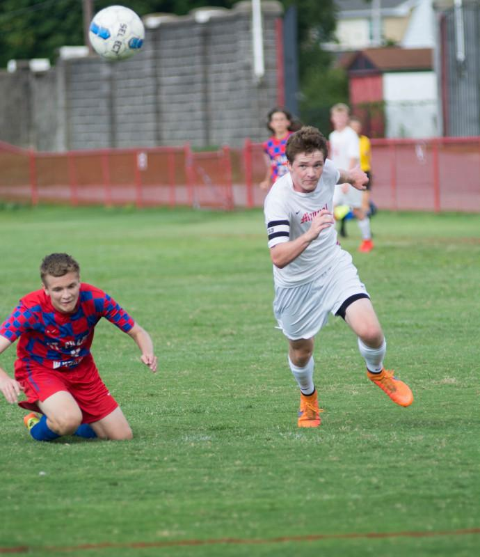 Dylan Barth (11,#9) rushes to the ball on a goal scoring opportunity. Photo by Luke Smith