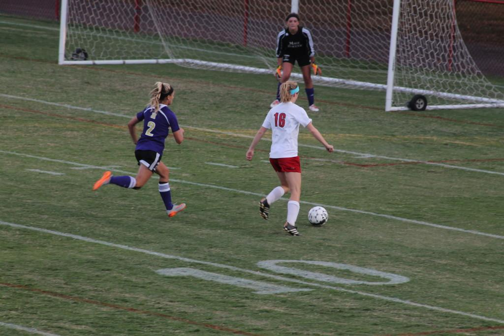 Madilyn Hord (11, #16) takes an open shot on goal. Photo by Shea Dobson