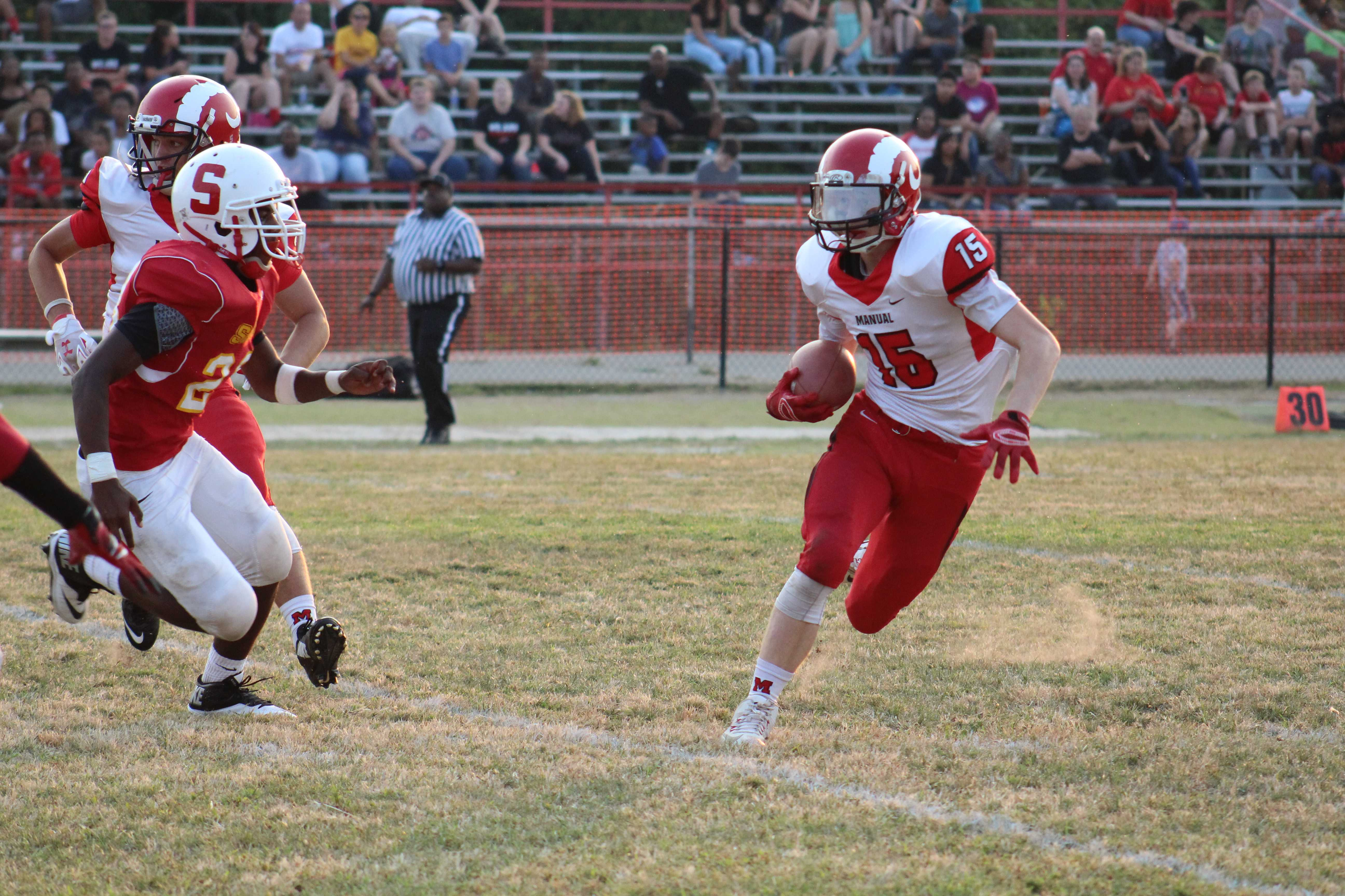 Will Marshall (#15) runs for a 50 yard touchdown on first down in the first quarter. Photo by Kate Hatter