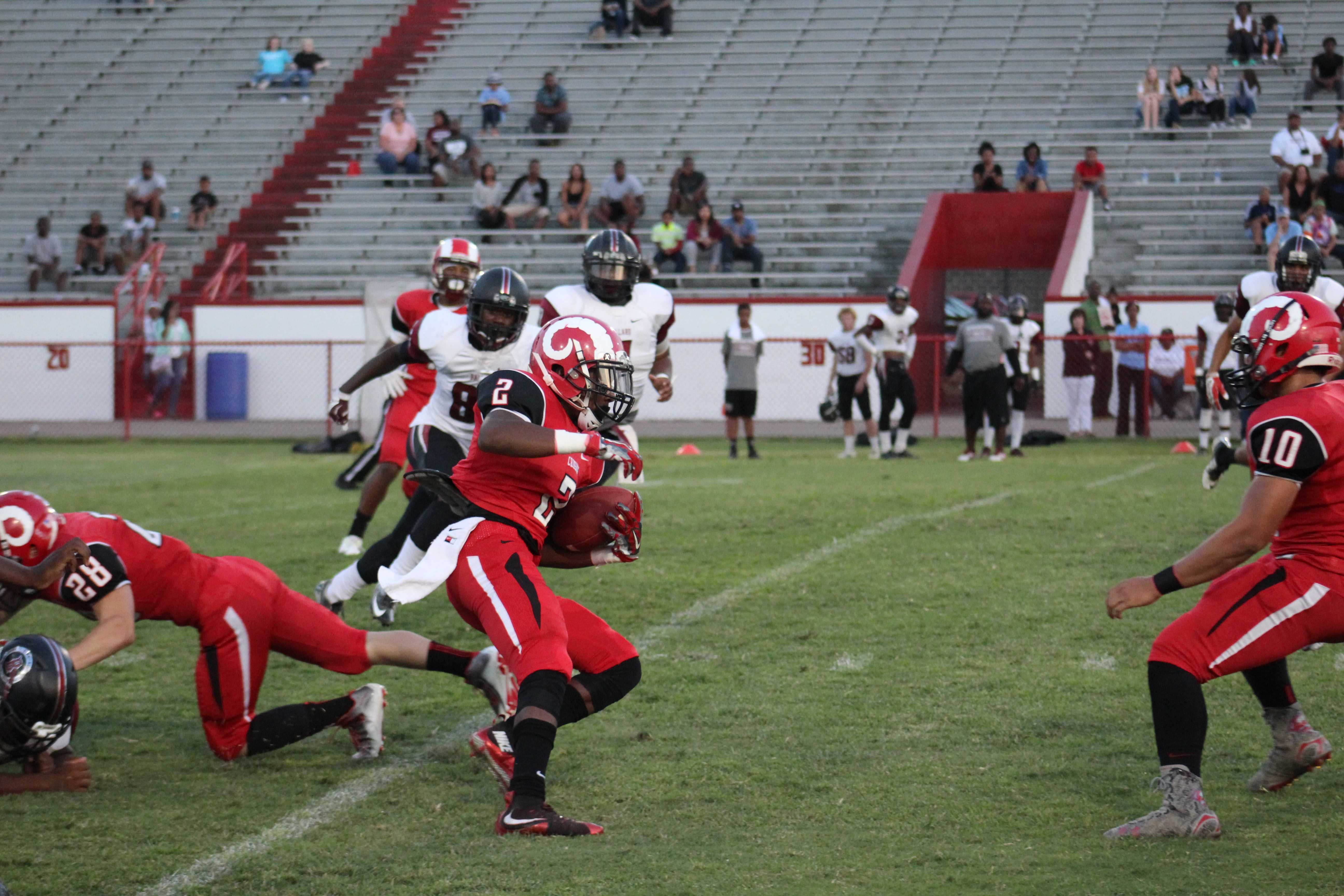 Crimsons take over at the 30 yard line after Omari Alexander's (12, #2) return in the first half. Photo by Kate Hatter