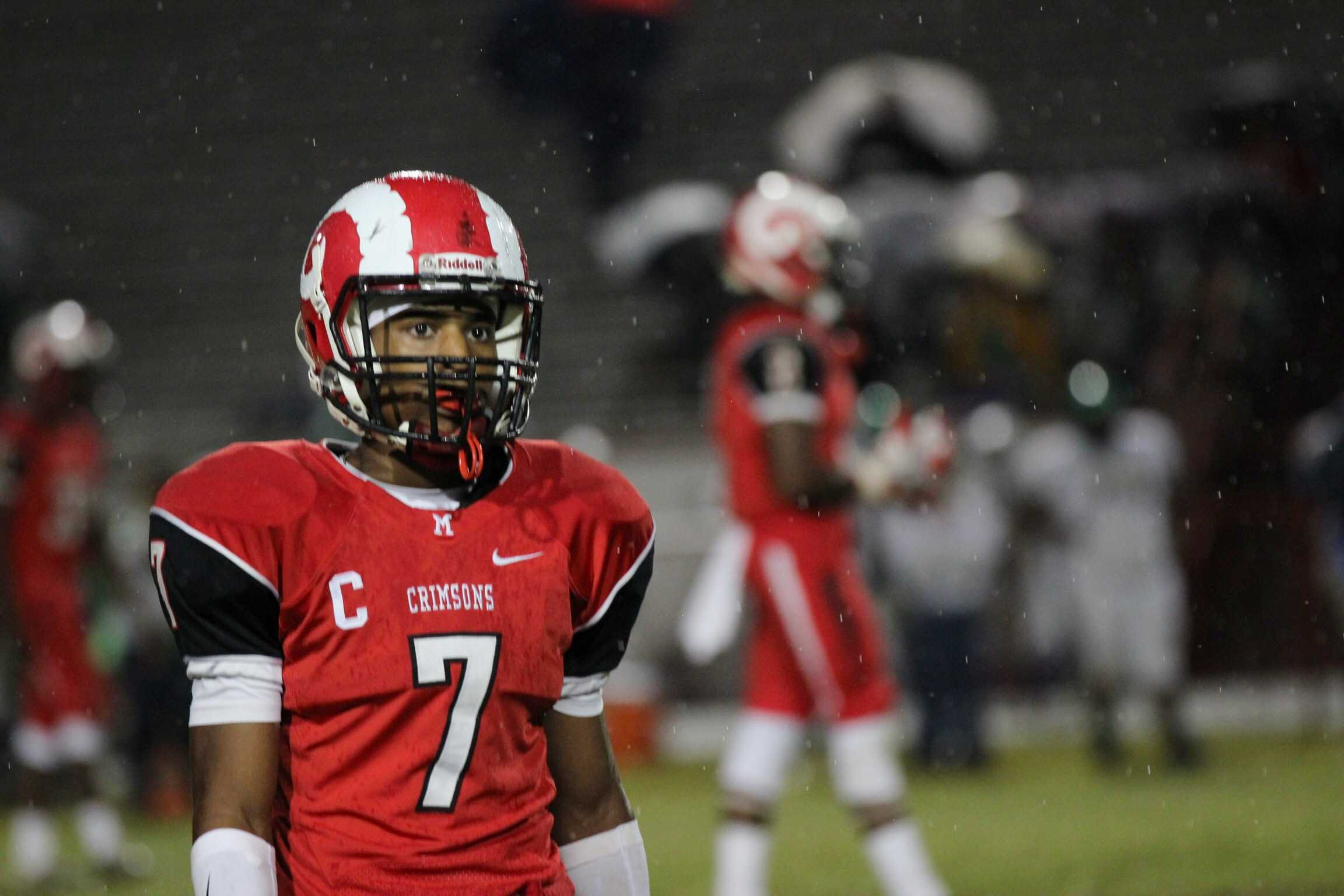 Bryce Cosby (11, #7) stars off into the heavy rain. Photo by Meaghan Sutton.