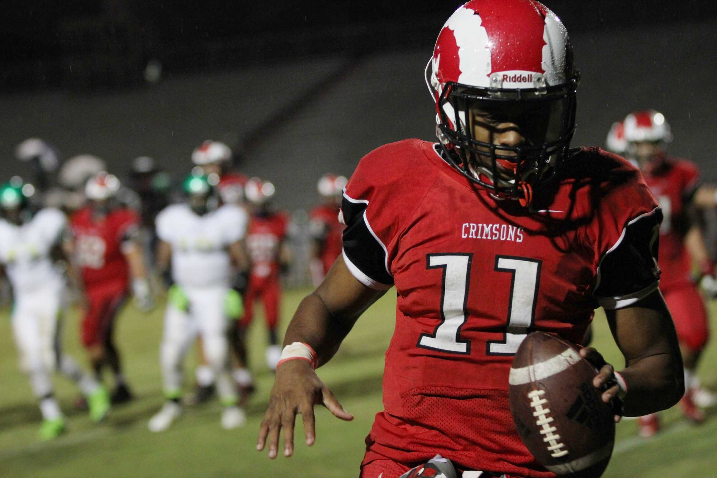 Receiver Jailen Cater (11, #11) after catching a one yard touchdown pass to give Manual a 28-0 lead in the second quarter. Photo by Meaghan Sutton.