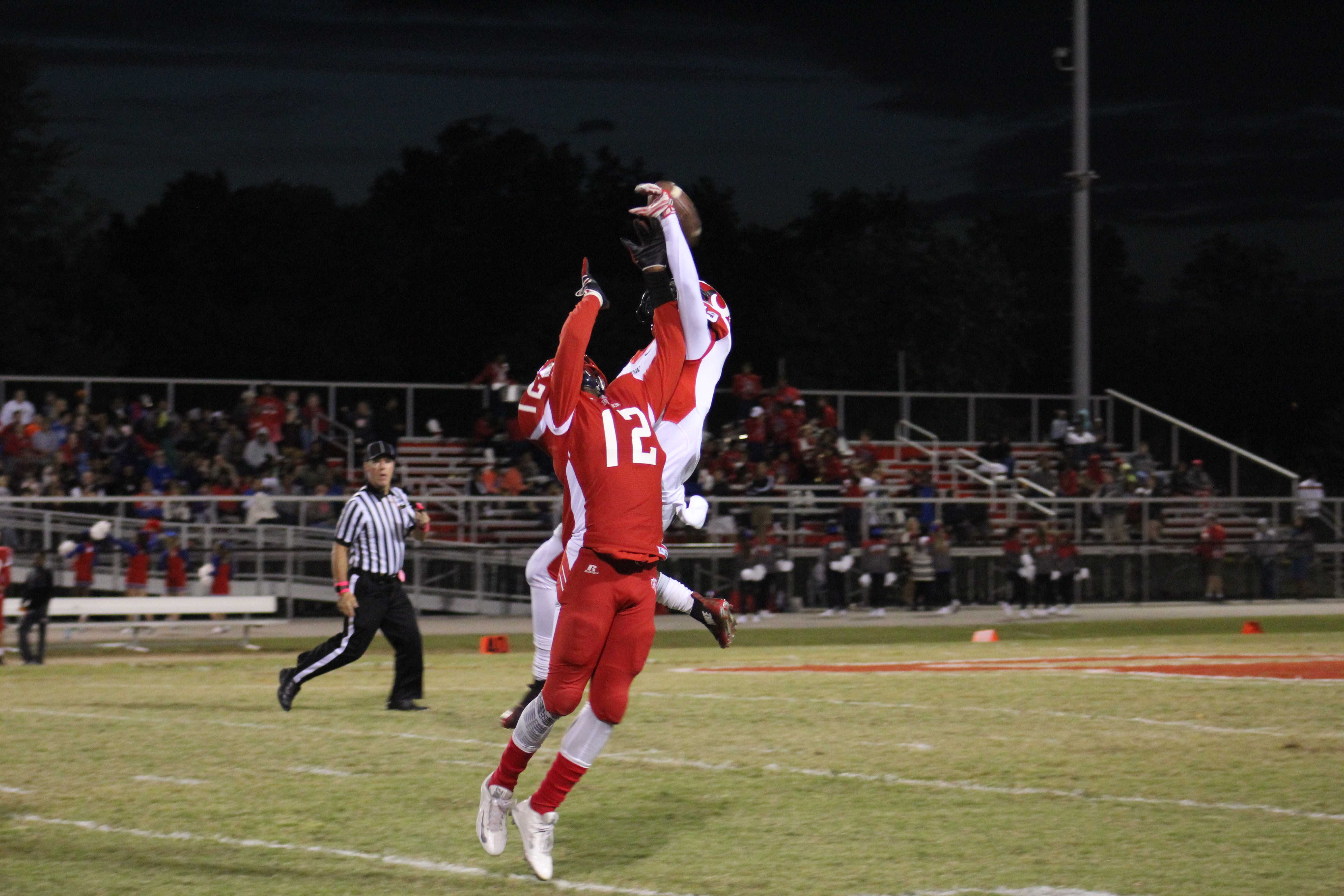 Omari Alexander (12, #2) attempts to catch a Butler pass but tips it instead. Photo by Kate Hatter