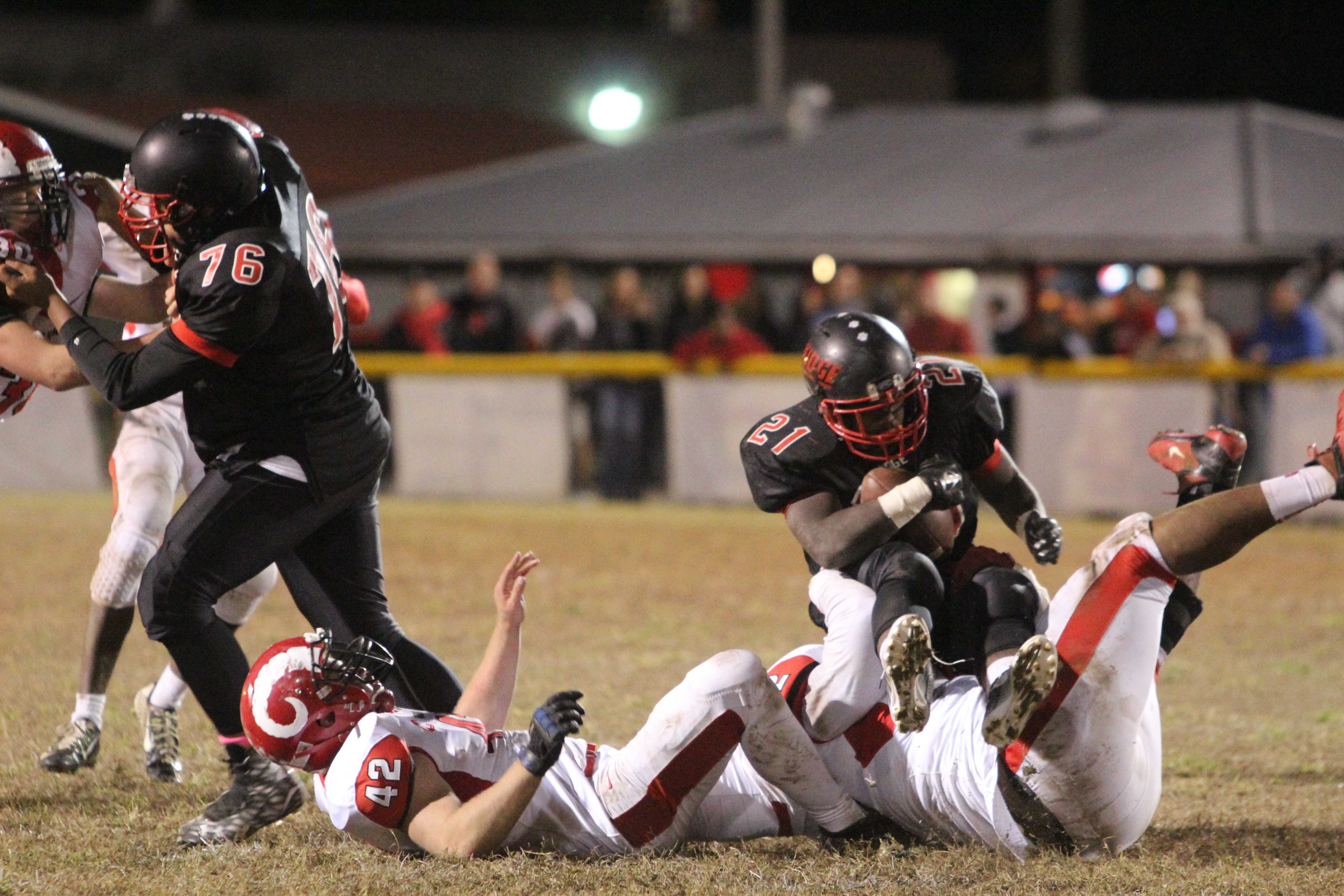 Sean Cleasant (11, #52) and Anthony Kyser (12, #42) take down PRP's Daniel Parker (12, #21). Photo by Kate Hatter