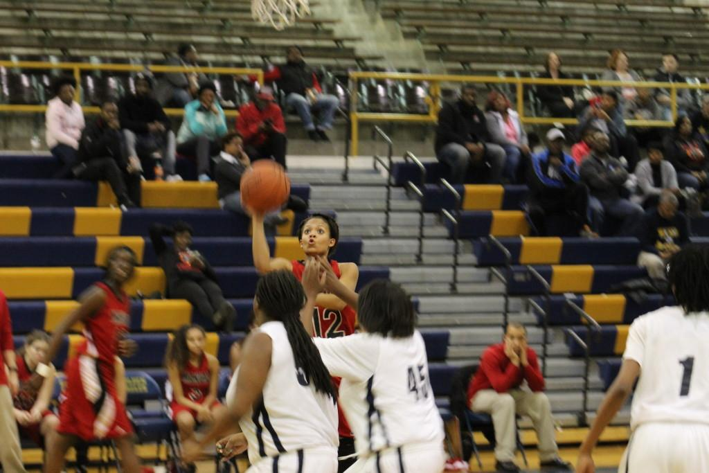 Tyonne Howard (12, #12) attempts a lay up. Photo by Kate Hatter