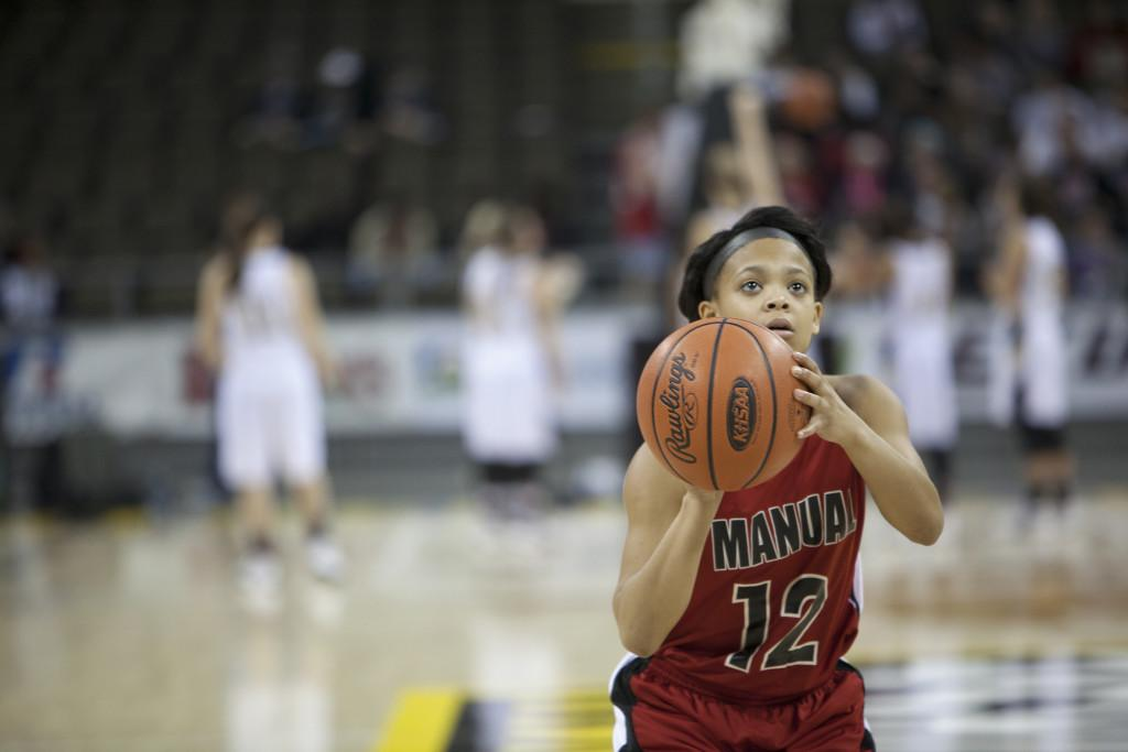Tyonne Howard (10, #12) shoots a free throw. Photo by Piper Cassetto.