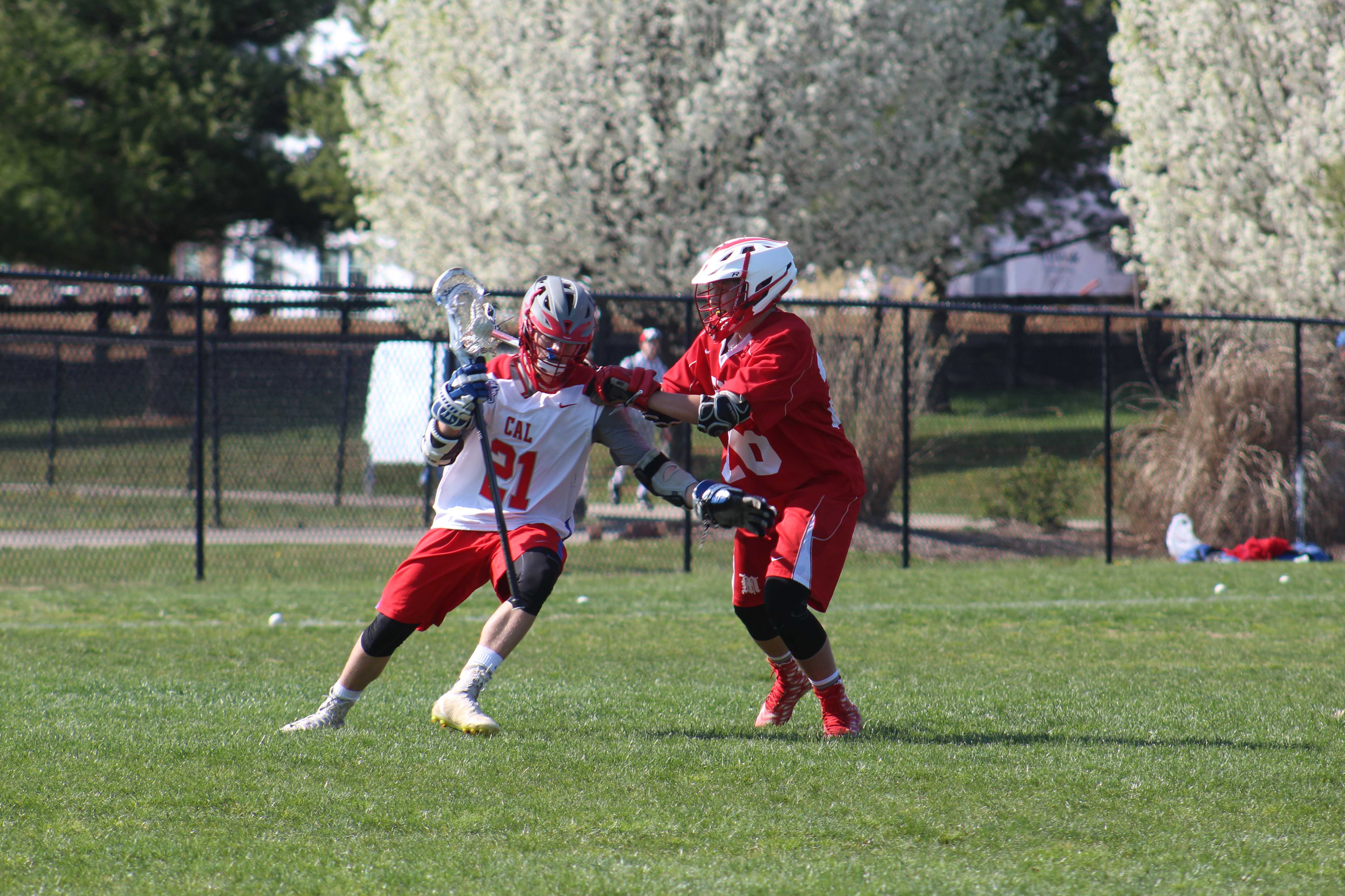 Late rally by Crimson boys' lacrosse team not enough to overcome KCD